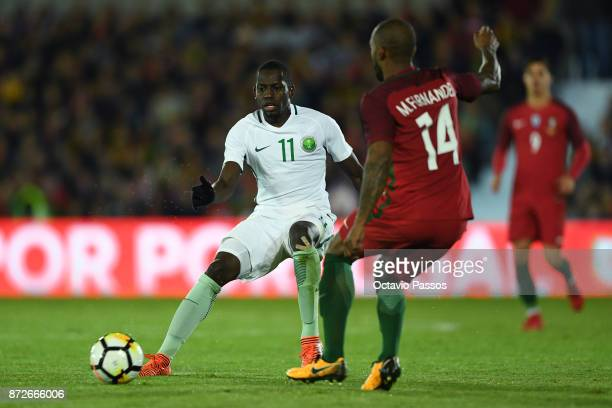 Manuel Fernandes of Portugal competes for the ball with Abdulmalek Alkhaibri of Saudi Arabia during the International Friendly match between Portugal...