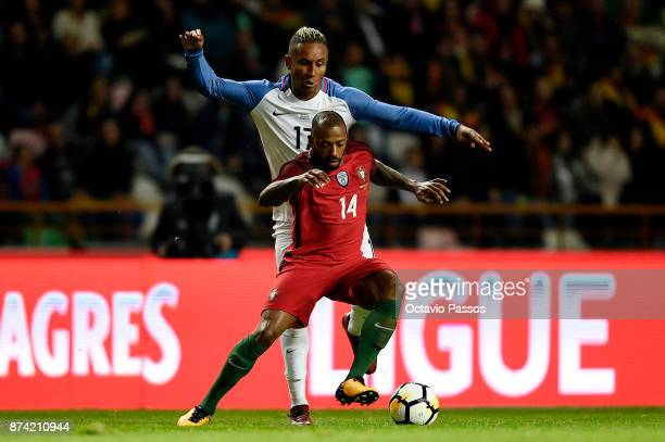 Manuel Fernandes of Portugal competes for the ball with Juan Agudelo during the International Friendly match between Portugal and USA at Estadio...