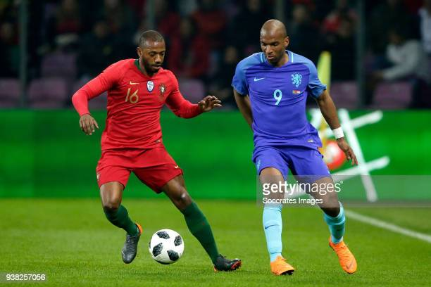 Manuel Fernandes of Portugal Ryan Babel of Holland during the International Friendly match between Portugal v Holland at the Stade de Geneve on March...