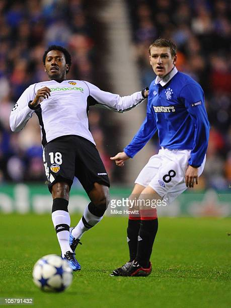 Manuel Fernandes of Valencia gets the ball past Steven Davis of Rangers during the UEFA Champions League Group C match between Glasgow Rangers FC and...