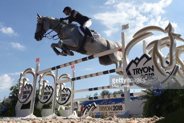 A competitor jumps an obstacle during the Show Jumping competition at the FEI World Equestrian Games on September 19 2018 at the Tryon International...