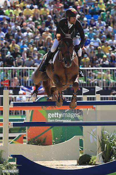Manuel Fernandez Saro of Spain rides U Watch during the Team Jumping on Day 11 of the Rio 2016 Olympic Games at the Olympic Equestrian Centre on...