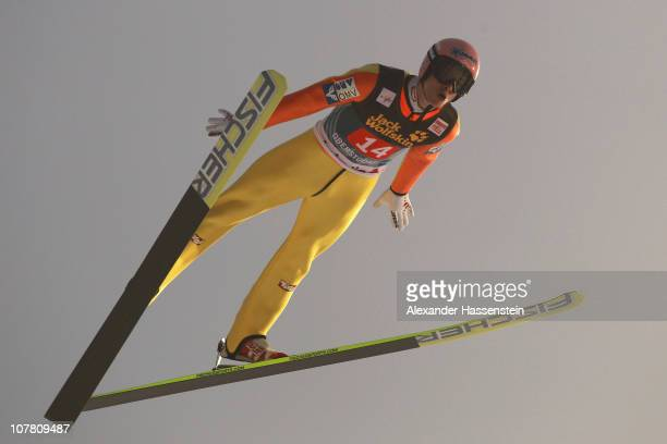 Manuel Fettner of Austria competes during the first round for the FIS Ski Jumping World Cup event at the 59th Four Hills ski jumping tournament at...