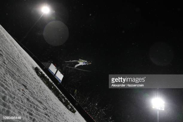 Manuel Fettner of Austria competes during the first round on day 8 of the 67th FIS Nordic World Cup Four Hills Tournament ski jumping event at...