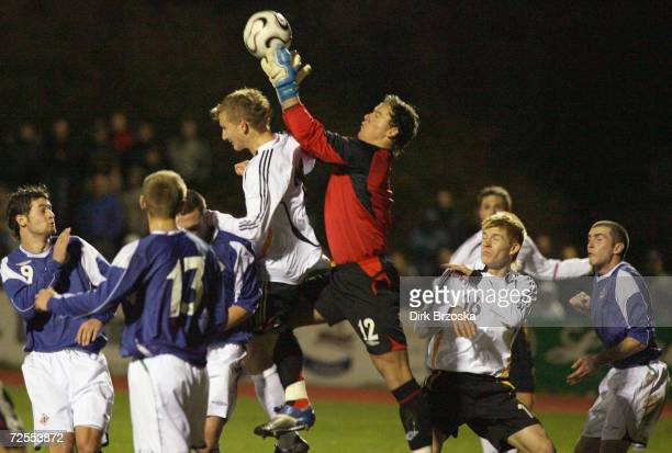 Manuel Fischer of Germany and keeper Jonathan Tuffey of Northern Ireland in action during the Men's U19 international friendly match between Germany...