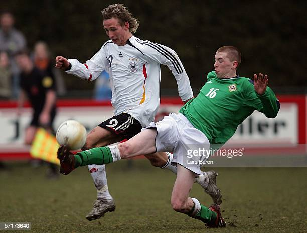 Manuel Fischer of Germany in action with William Burns of Northern Ireland during the Men's Under 17 European Championship qualifier match between...