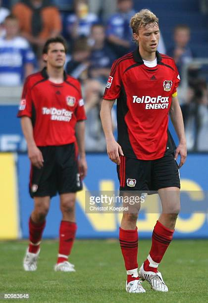 Manuel Friedrich and Simon Rolfes of Leverkusen show their frustration after loosing 23 the Bundesliga match between MSV Duisburg and Bayer...
