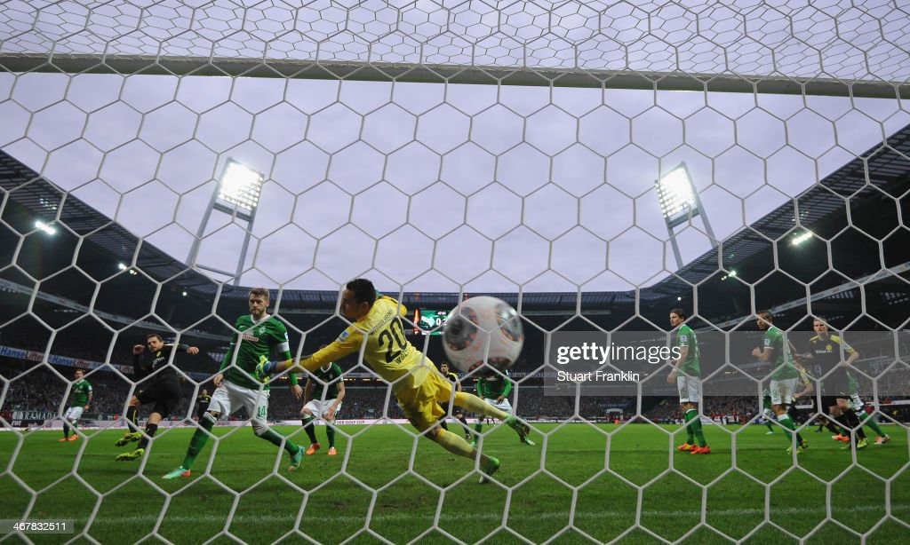 Manuel Friedrich of Dortmund scores his goal during the Bundesliga match between Werder Bremen and Borussia Dortmund at Weserstadion on February 8, 2014 in Bremen, Germany.