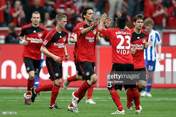 Manuel Friedrich of Leverkusen celebrates his team's first goal with team mates during the Bundesliga match between Bayer Leverkusen and Hertha BSC...