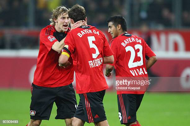 Manuel Friedrich of Leverkusen celebrates the first goal with Stefan Kiessling of Leverkusen during the Bundesliga match between Bayer Leverkusen and...