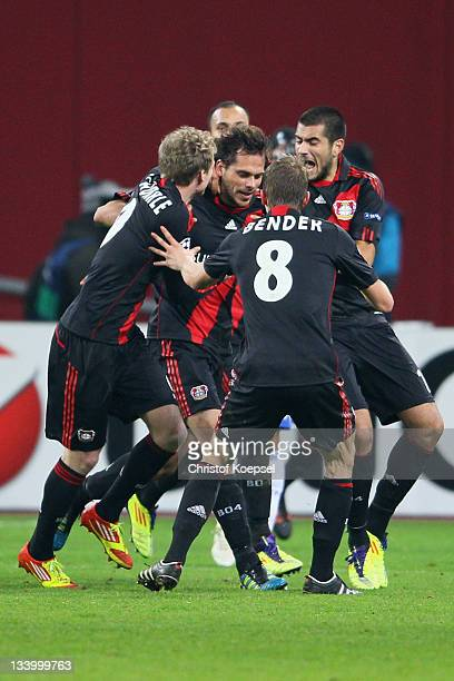 Manuel Friedrich of Leverkusen celebrates the second goal with Andre Schuerrle Lars Bender and Eren Derdiyok during the UEFA Champions League group E...