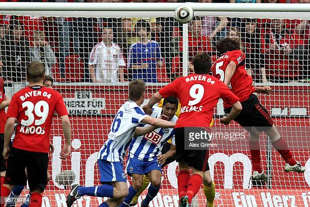 Manuel Friedrich of Leverkusen scores his team's first goal during the Bundesliga match between Bayer Leverkusen and Hertha BSC Berlin at the...