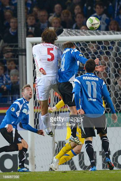 Manuel Friedrich scores his teams second goal against Dennis Riemer Tom Schuetz Patrick Platins and Stephan Salger of Bielefeld during the DFB Cup...