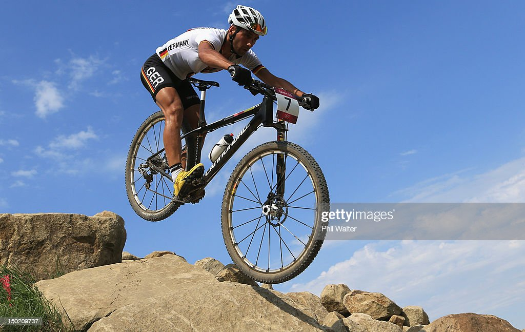 Manuel Fumic of Germany competes in the Men's Cross-country Mountain Bike race on Day 16 of the London 2012 Olympic Games at Hadleigh Farm on August 12, 2012 in Hadleigh, England.