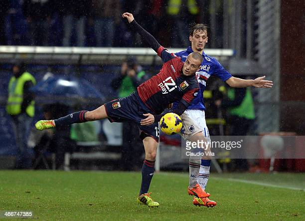Manuel Gabbiadini of UC Sampdoria and Luca Antonelli of Genoa CFC compete for the ball during the Serie A match between Genoa CFC and UC Sampdoria at...