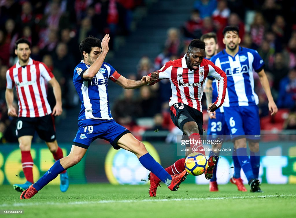 Manuel Garcia of Deportivo Alaves competes for the ball with Inaki Williams of Athletic Club during the La Liga match between Athletic Club Bilbao and Deportivo Alaves at San Mames Stadium on January 7, 2018 in Bilbao, Spain.