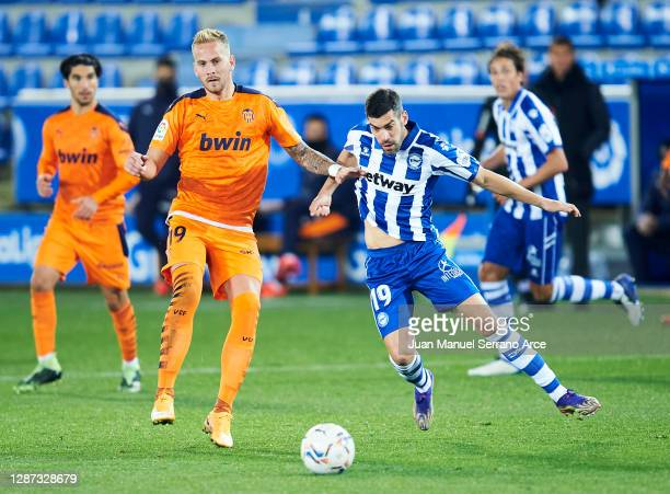 Manuel Garcia of Deportivo Alaves duels for the ball with Uros Racic of Valencia CF during the LaLiga Santander match between Alaves and Valencia on...