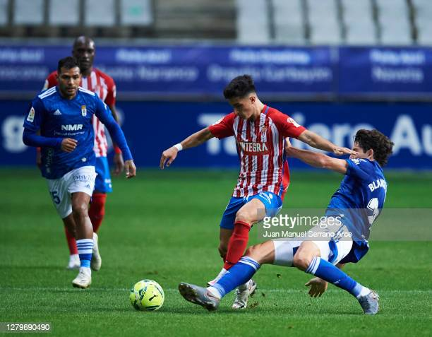 Manuel Garcia of Real Sporting Gijon duels for the ball with Blanco Leschuk of Real Oviedo during the La Liga Smartbank match between Oviedo and Real...