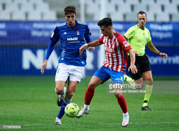Manuel Garcia of Real Sporting Gijon duels for the ball with Edgar Gonzalez of Real Oviedo during the La Liga Smartbank match between Oviedo and Real...