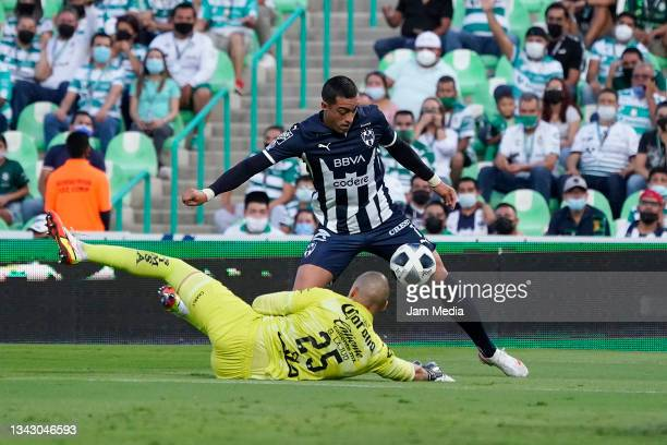 Manuel Gibran Lajud goalkeeper of Santos fights for the ball with Rogelio Gabriel Funes Mori of Monterrey during the 10th round match between Santos...