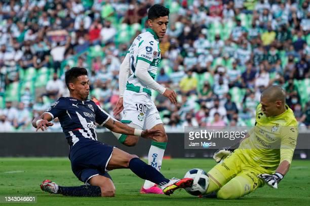 Manuel Gibran Lajud goalkeeper of Santos fights for the ball with Maximiliano Eduardo Meza of Monterrey during the 10th round match between Santos...