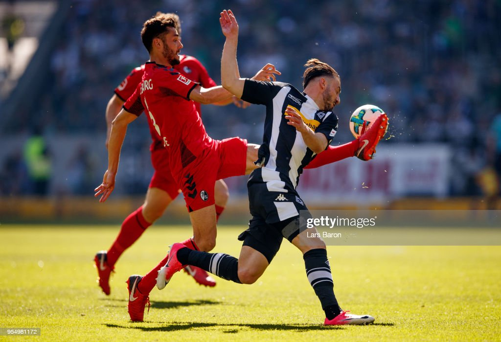Manuel Gulde of Freiburg challenges Josip Drmic of Moenchengladbach during the Bundesliga match between Borussia Moenchengladbach and Sport-Club Freiburg at Borussia-Park on May 5, 2018 in Moenchengladbach, Germany.