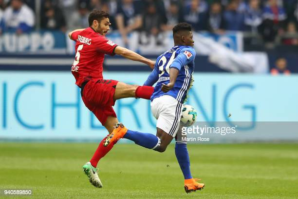 Manuel Gulde of Freiburg fights for the ball with Breel Embolo of Schalke during the Bundesliga match between FC Schalke 04 and SportClub Freiburg at...