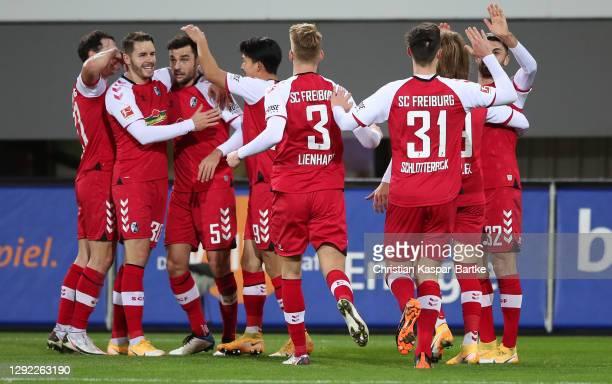 Manuel Gulde of SC Freiburg celebrates with teammates after scoring their team's third goal during the Bundesliga match between Sport-Club Freiburg...