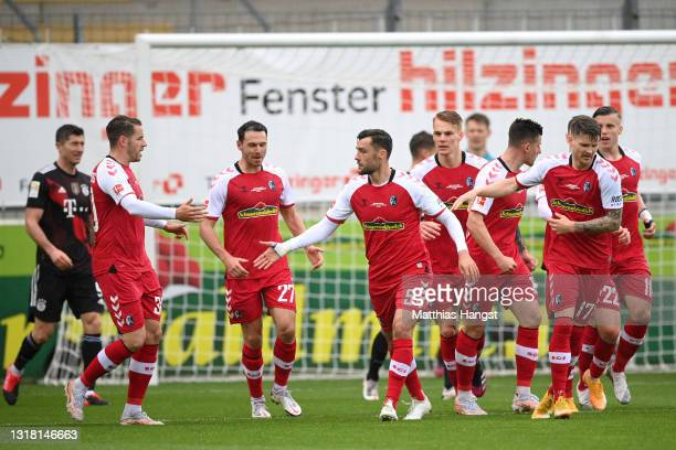 Manuel Gulde of Sport-Club Freiburg celebrates with team mates after scoring their side's first goal during the Bundesliga match between Sport-Club...