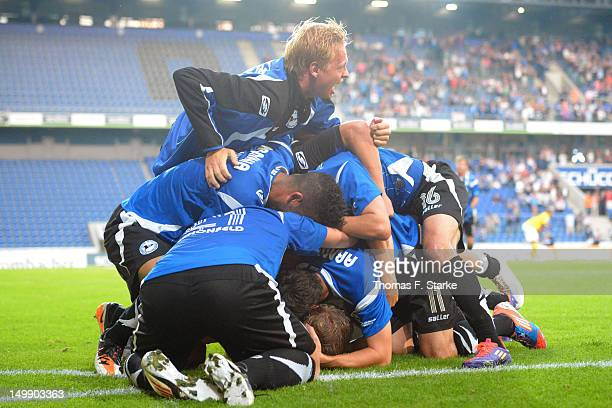 Manuel Hornig of Bielefeld celebrates on top of his teammates during the Third League match between Arminia Bielefeld and 1 FC Saarbruecken at...