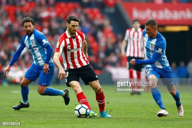 Manuel Iturra of Malaga CF Aritz Aduriz of Athletic Bilbao Maxime Lestienne of Malaga CF during the La Liga Santander match between Athletic de...