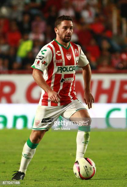 Manuel Iturra of Necaxa drives the ball during the 17nd round match between Necaxa and Morelia as part of the Torneo Apertura 2017 Liga MX at...