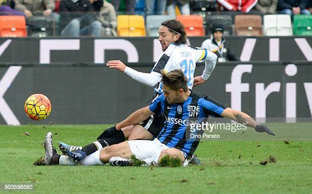 Manuel Iturra of Udinese Calcio is tackled to Rafael Toloi of Atalanta BC during the Serie A match between Udinese Calcio v Atalanta BC at Stadio...