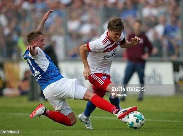 Manuel Janzer of Holstein Kiel and Goutoku Sakai of Hamburg battle for the ball during the preseason friendly match between Holstein Kiel and...