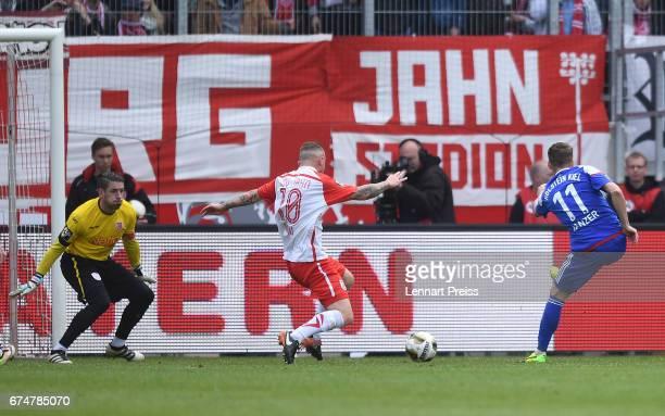 Manuel Janzer of Holstein Kiel scores his side's third goal during the 3 Liga match between Jahn Regensburg and Holstein Kiel on April 29 2017 in...