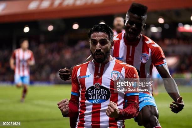 Manuel Jesus Vazquez 'Chuli' of CD Lugo celebrates with his teammates after scoring his team's first goal during the La Liga 123 match between CD...