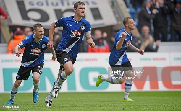 Manuel Junglas, Fabian Klos and Christoph Hemlein of Bielefeld celebrate their teams first goal during the Third League match between Arminia...