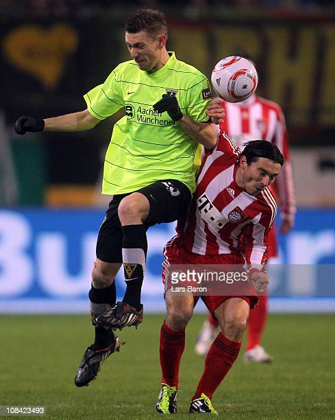 Manuel Junglas of Aachen challenges Danijel Pranjic of Muenchen during the DFB Cup quarter final match between Alemannia Aachen and Bayern Muenchen...