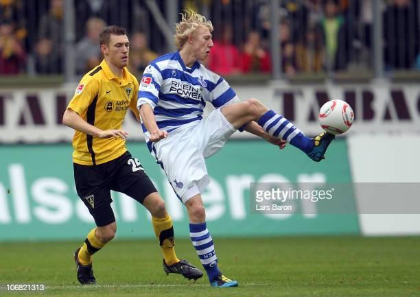 Manuel Junglas of Aachen challenges Julian Koch of Duisburg during the Second Bundesliga match between Alemannia Aachen and MSV Duisburg at Tivoli...
