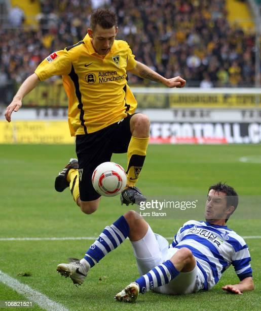 Manuel Junglas of Aachen jumps over Goran Sukalo of Duisburg during the Second Bundesliga match between Alemannia Aachen and MSV Duisburg at Tivoli...