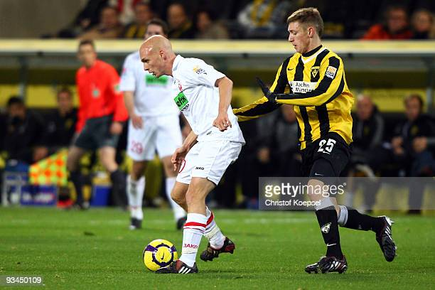 Manuel Junglas of Aachen tackles NilsOle Book of Ahlen during the second Bundesliga match between Alemannia Aachen and Rot Weiss Ahlen at the Tivoli...