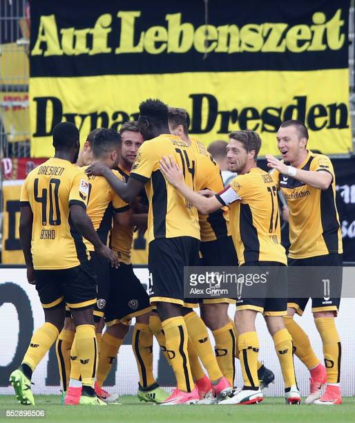 Manuel Konrad of Dresden celebrates his team's first goal with team mates during the Second Bundesliga match between SV Darmstadt 98 and SG Dynamo...