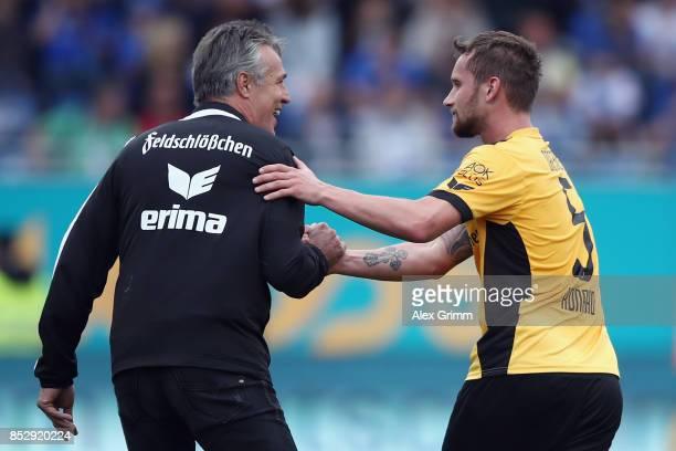 Manuel Konrad of Dresden celebrates his team's third goal with head coach Uwe Neuhaus during the Second Bundesliga match between SV Darmstadt 98 and...