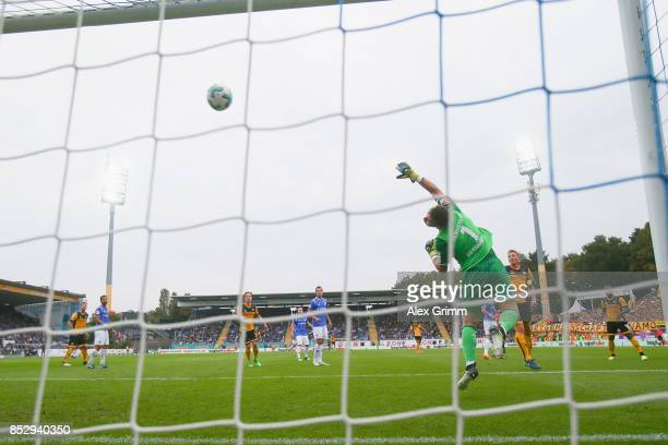 Manuel Konrad of Dresden scores his team's third goal past goalkeeper Daniel Heuer Fernandes of Darmstadt during the Second Bundesliga match between...