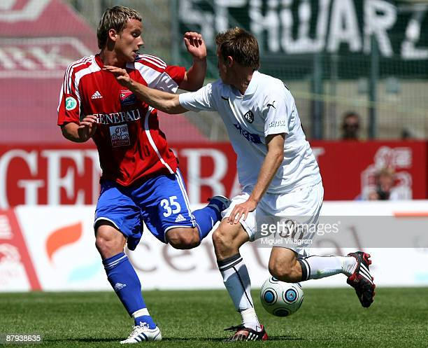 Manuel Konrad of Unterhaching and Steffen Bohl of Aalen challenge for the ball during the 3 Liga match between SpVgg Unterhaching and VfR Aalen at...