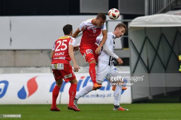 Manuel Krainz of FC Linz Lukas Tursch of FC Linz and Marko Raguz of Juniors OOe during the 2 Liga match between FC Juniors OOe v FC Blau Weiss Linz...