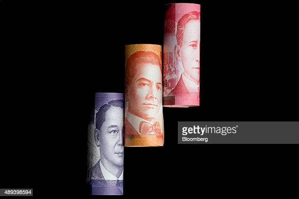 Manuel L Quezon left to right Manuel Acuna Roxas and Sergio Osmena former presidents of the Philippines are displayed on one hundred left to right...