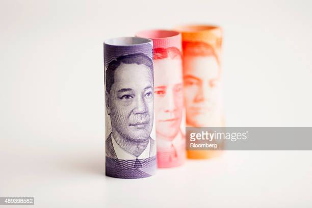 Manuel L Quezon left to right Sergio Osmena and Manuel Acuna Roxas former presidents of the Philippines are displayed on one hundred left to right...