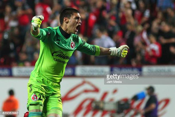 Manuel Lajud goalkeeper of Tijuana celebrates the first goal of his team scored by his teammate Gustavo Bou during the seventh round match between...