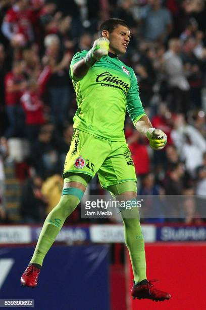 Manuel Lajud goalkeeper of Tijuana celebrates the second goal of his team scored by his teammate Diego Musto during the seventh round match between...